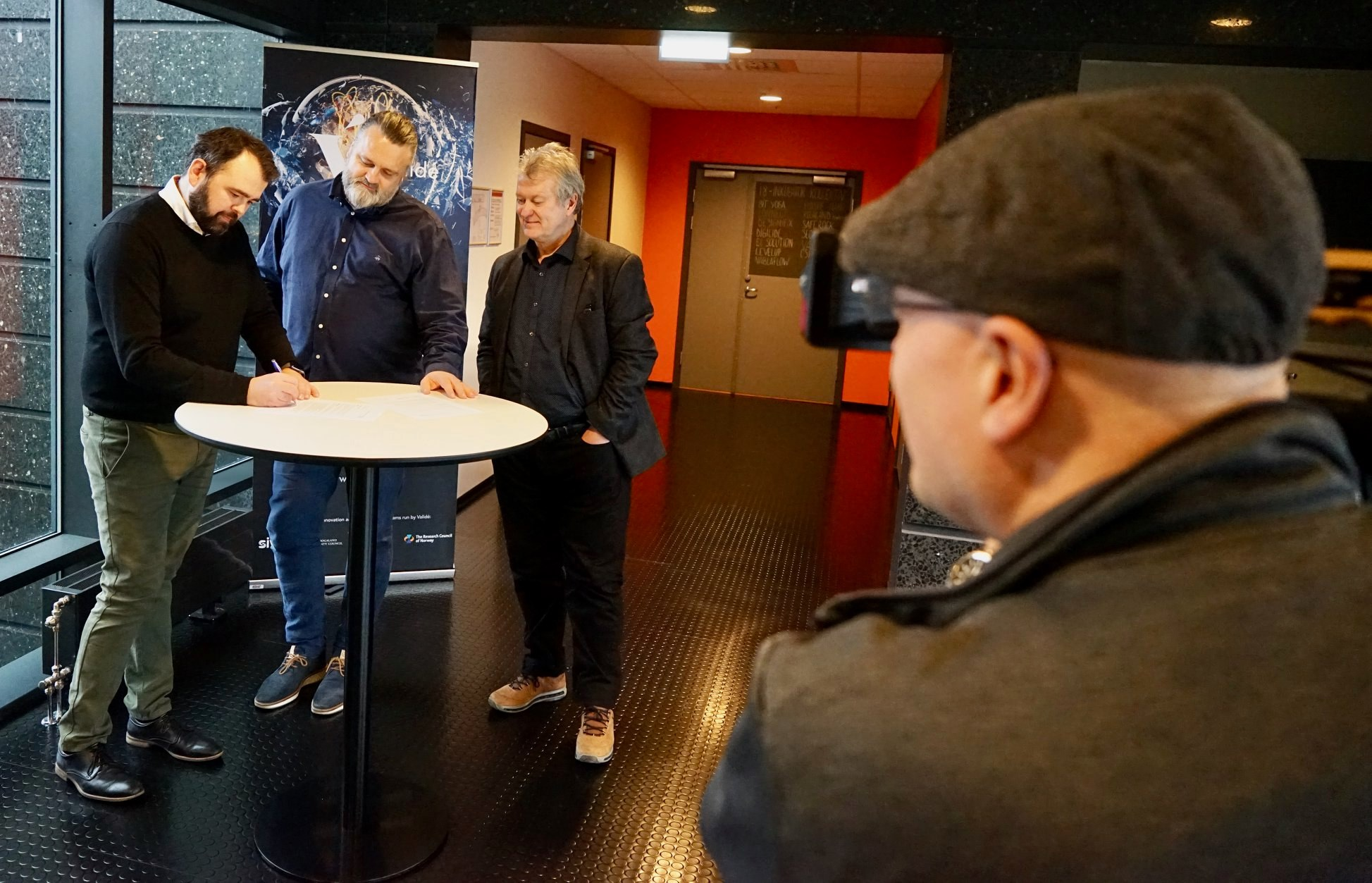 Co-founders signing an investment deal with Valide Haugesund