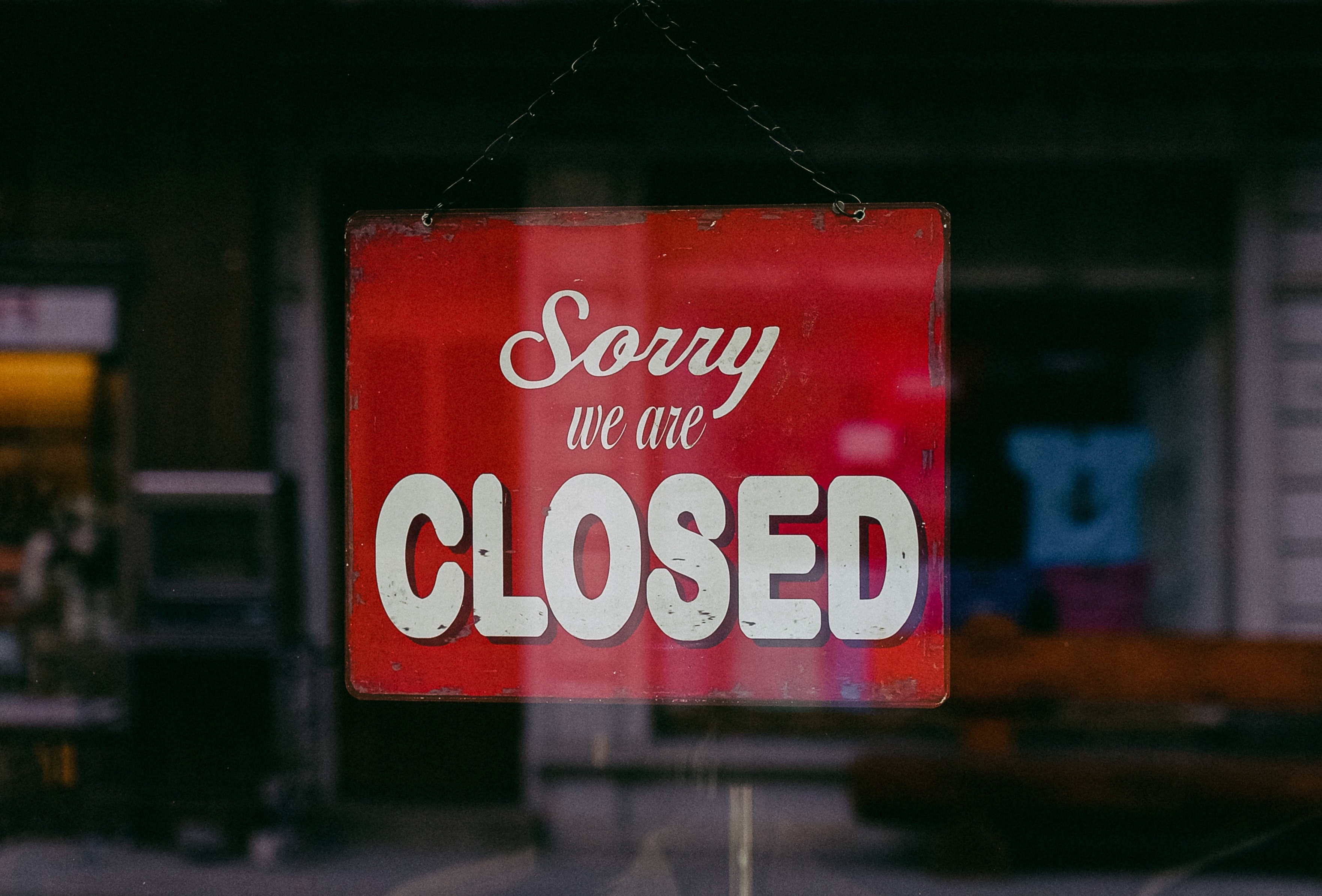 Sign on door saying Sorry, we're closed